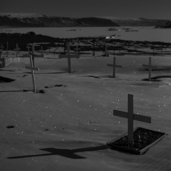 The cemetery in the abandon village of Dundas. An entire Inuit community was forcibly relocated from here when the American Thule Air Base was built in the 1950s. Later a B-52-plane carrying atomic bombs crashed nearby, and according to local Inuits, contaminated the environment and wild life.